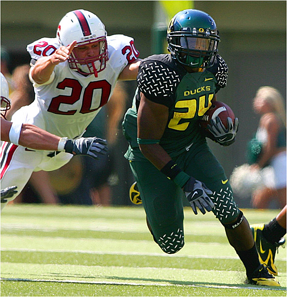 Jeremiah Johnson (right) ran 10 times for 79 yards as the Ducks accounted for 298 yards on the ground.