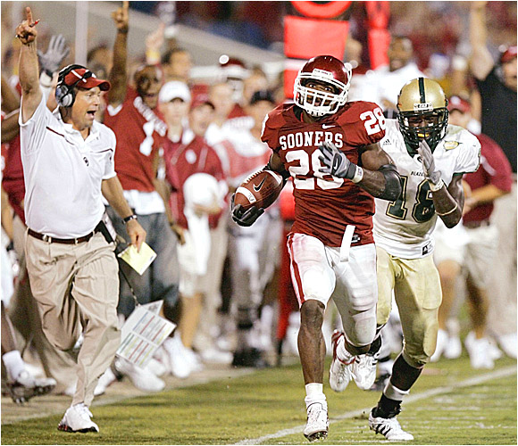 Adrian Peterson (28) rumbled for 139 yards and a touchdown on 24 carries and had one reception for 69 yards and a score as the Sooners dodged another season-opening defeat.