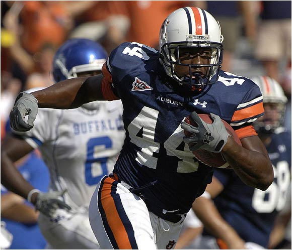 Tigers running back Ben Tate, who had 114 yards on just seven carries, breaks free on a 42-yard touchdown run.