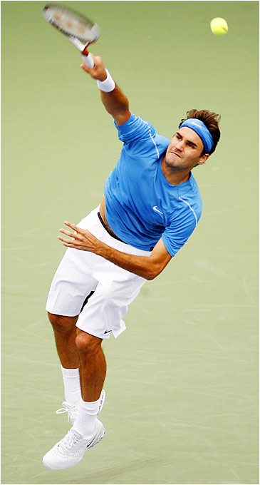 Two-time defending U.S. Open champion Roger Federer serves in his first-round match with Yeu-Tzuoo Wang on Aug. 30.  Federer won 6-4, 6-1, 6-0.