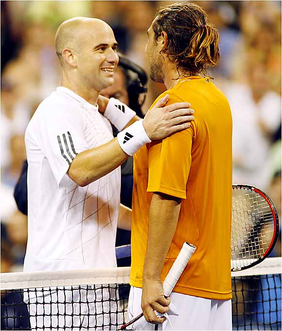 Andre Agassi, 36, and Marcos Baghdatis, 21, congratulate one another at center court after a nearly four-hour match on Aug. 31.