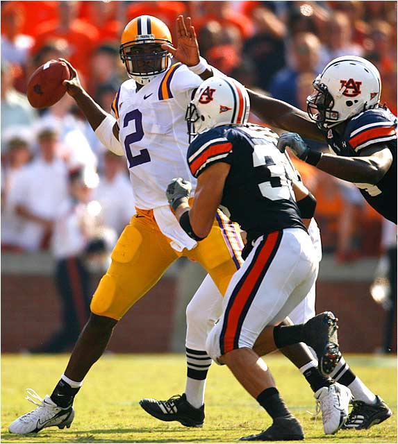 LSU quarterback JaMarcus Russell gets off a pass despite Auburn pressure. Russell was 20 of 35 for 269 yards, but his offense could generate only a field goal.