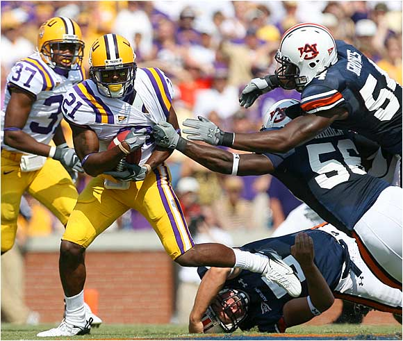 Chevis Jackson of LSU tries to get past Auburn's Courtney Harden (56) and Quentin Groves (54) on a punt return.