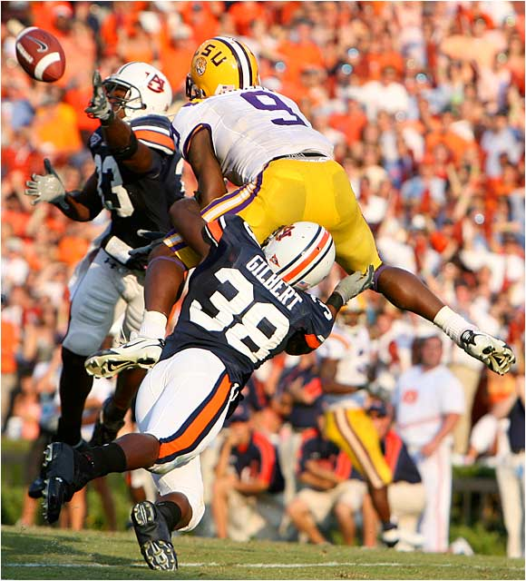 In the game's most controversial play, late in the fourth quarter, Auburn's Eric Brock slaps away a pass to LSU's Early Doucet as Auburn's Zach Gilbert grabs Doucet. Pass interference was nullified because the ball was tipped.
