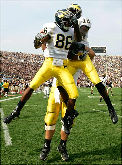 Michigan's Mario Manningham (86) celebrates after catching a touchdown pass that gave the Wolverines a 27-7 lead.