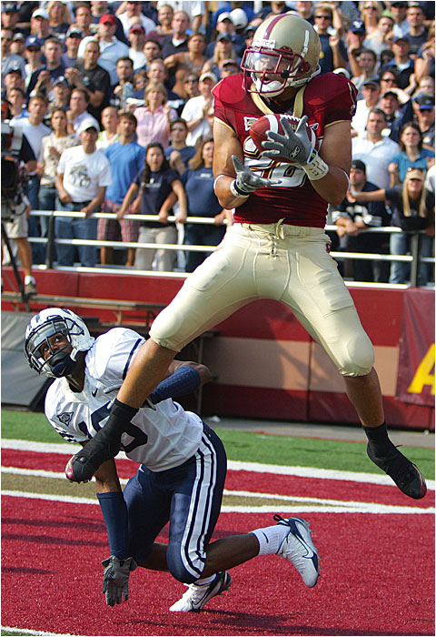 BC's Tony Gonzalez hauls in the winning touchdown in the second overtime as BYU's Justin Robinson looks on.