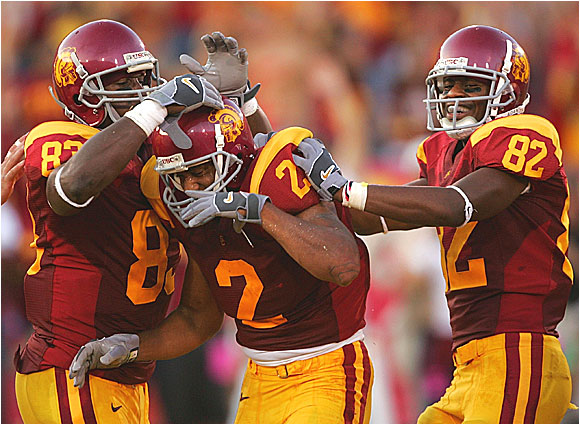 Wide receiver Steve Smith (center) is congratulated by receivers Fred Davis (left) and Chris McFoy after Smith hauled in one of John David Booty's three touchdown passes.