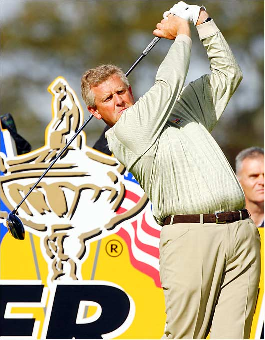 Colin Montgomerie hits from the 13th during his morning four-ball match. He and Padraig Harrington fell to Tiger Woods and Jim Furyk for Europe's only loss of the day.