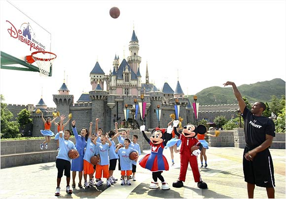 In Los Angeles, Kobe isn't too far from the original Disneyland, so he probably enjoyed seeing some familiar faces (Mickey and Minnie, for instance) at the Hong Kong Disneyland. It's a small world, after all.