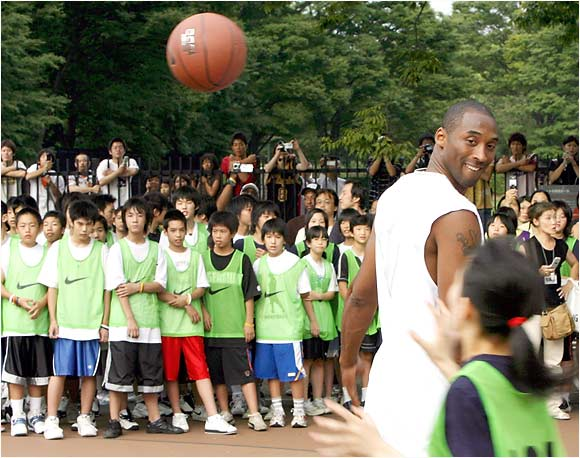 "Kobe Bryant's first stop in his five-city ""81 Asia Tour"" in early September was in Tokyo, where he held a basketball clinic for youngsters. As he soon found out, a behind-the-back pass is appreciated just as much in Japan as in the U.S."