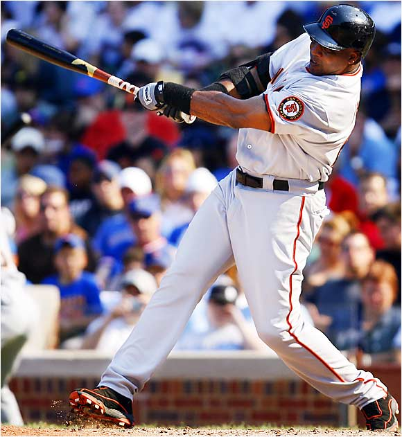 Barry Bonds blasts a solo home run, the 729th of his career, in the eighth inning of the Giants' 7-4 win over the Cubs at Wrigley Field on Sunday.  The suddenly sizzliing Bonds has nailed five homers in his last 11 games while raising his average to .263 from .241 at the start of August.