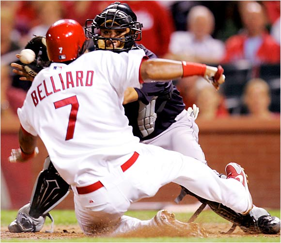 Ronnie Belliard of the Cardinals beats the throw to Marlins catcher Miguel Olivo and scores in the third inning at Busch Stadium on Aug 30.  The Cards won the game, 13-6, and remained perched atop the NL Central. The Marlins continued to battle in a tight race for the NL Wild Card.