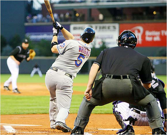 Rockin' the Rockie: David Wright of the Mets rips a grand slam off Josh Fogg of the Rockies in the first inning of New York's 11-3 win at Coors Field on Aug. 30.  The torrid Wright raked last week, hitting .522 with 15 RBIs.