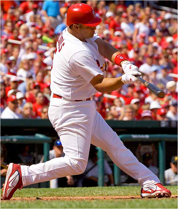 Albert Pujols blasts the second of his three home runs against the Pirates at Busch Stadium on Sunday.  The St. Louis slugger, who also homered three times against the Reds on April 16, had five RBIs in the Cards' 6-3 win over Pittsburgh.