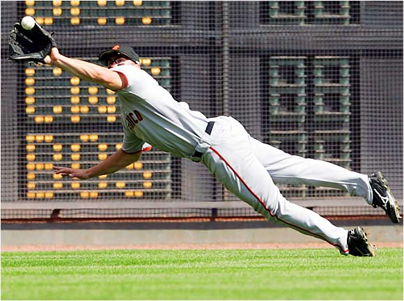 Giants left fielder Todd Linden dives to catch a line drive by the Reds' Juan Castro in the ninth to help preserve a 3-2 victory on Sept. 6.