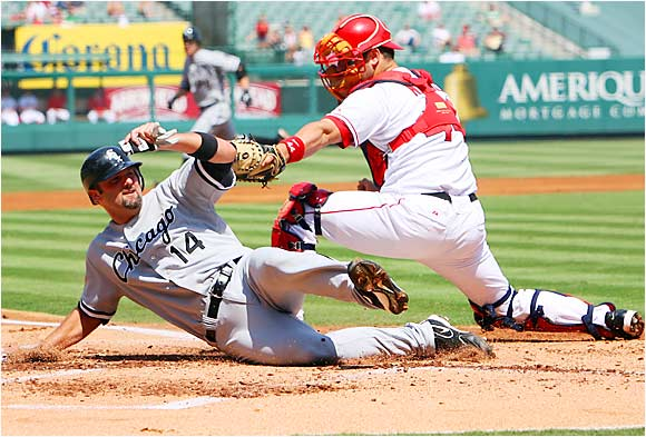 The White Sox' Paul Konerko beat the tag at home by Mike Napoli to score a run in the second inning at Angel Stadium on Sept. 13. Konerko went 4 for 4 with a run and two RBIs in the Sox' 9-0 victory.