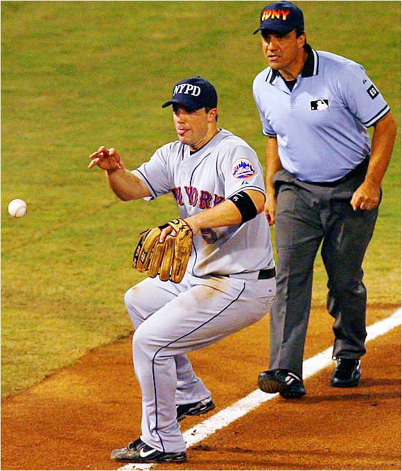 Mets third baseman David Wright barehanded the ball in front of umpire Phil Cuzzi and threw out Josh Willingham at first in the second inning of the Mets' 16-5 defeat on Sept. 11. Both teams wore caps to honor the seven New York City departments that suffered losses five years ago.
