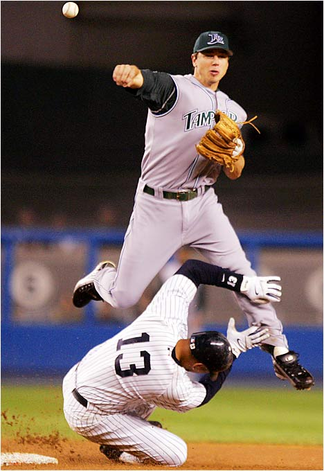 The Yankees' Alex Rodriguez broke up a double play attempt by Devil Rays shortstop Ben Zobrist, allowing Jason Giambi to reach first and Derek Jeter to score on the play in the first inning of an 8-4 win for the Yankees on Sept. 13.
