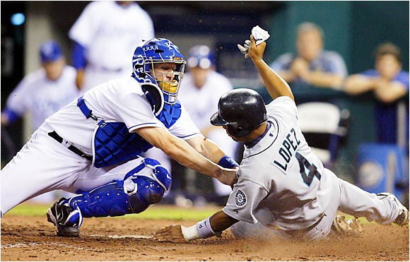 Royals catcher John Buck tags out Jose Lopez in the sixth inning on Sept. 14. The Royals beat the Mariners 10-8.