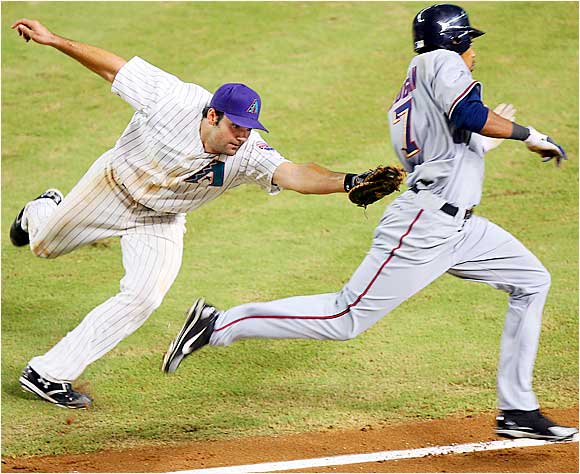 The Nationals' Nook Logan reaches first on a bunt, just avoiding the tag attempt by Diamondbacks first baseman Conor Jackson in the eighth inning of a 4-2 win for the D-Backs on Sept. 13.
