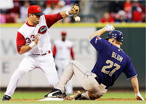 The Padres' Geoff Blum beats the throw to Reds shortstop Rich Aurilia in the second inning on Sept. 13. Cincy lost the game 10-0, falling even farther behind San Diego in the wild-card race.