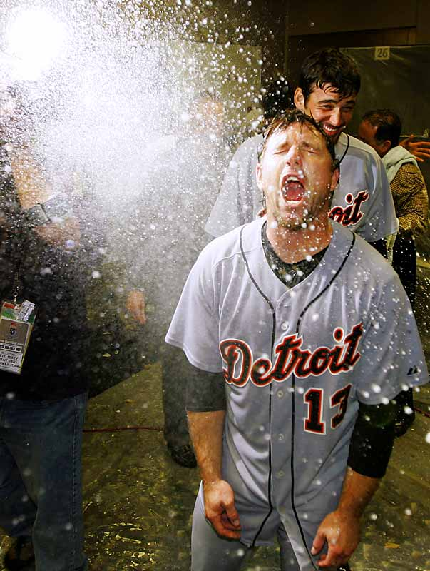 Detroit catcher Vance Wilson is doused with champagne after the Tigers clinched a playoff berth with an 11-4 win against the Royals on Sunday.