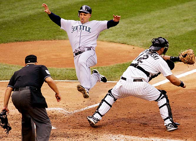 The Mariners' Raul Ibañez scores on a single by teammate Eduardo Perez, ahead of the throw to White Sox catcher A.J. Pierzynski in the fifth inning of Chicago's 11-7 victory on Saturday.