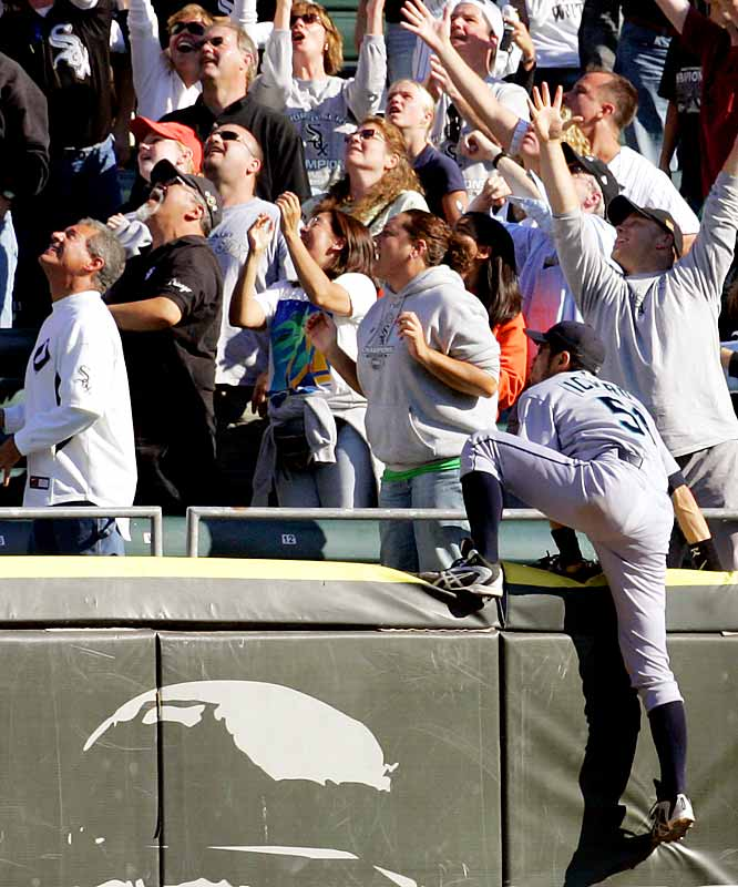 Mariners center fielder Ichiro Suzuki watches the second home run of the game by the White Sox's Paul Konerko after climbing the outfield wall in the eighth inning of a 12-7 loss for Seattle on Sunday.