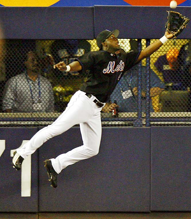 Mets left fielder Lastings Milledge makes a leaping catch on a fly ball by the Marlins' Hanley Ramirez during the Mets' 3-2 win on Sept. 19.