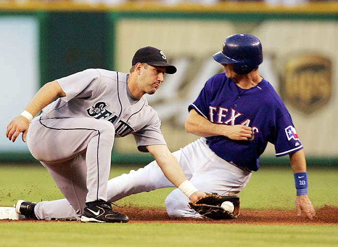 The Rangers' Michael Young beats the throw to Seattle second baseman Willie Bloomquist for a stolen base in the first inning of the Mariners' 9-7 win on Sept. 19.