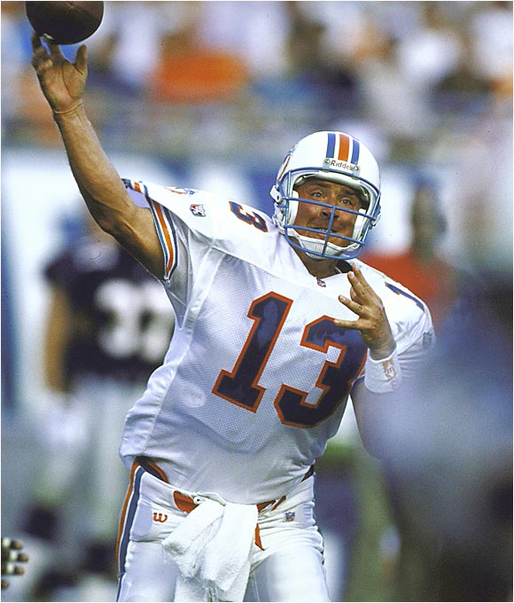 Marino's numbers may never be topped in the NFL. The Dolphins great completed 4,967 of 8,358 passes for 61,361 yards and threw 420 touchdowns during his 242-game NFL career. He wasn't fleet of foot, but his quick release helped him avoid sacks and consistently led the Dolphins to huge scoring seasons.