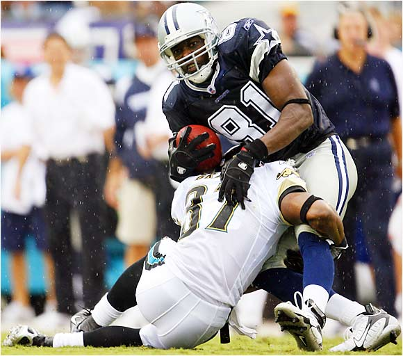 Cowboys receiver Terrell Owens caught six passes for 80 yards and a touchdown in his regular-season debut with Dallas, but the Jaguars' defense picked off quarterback Drew Bledsoe three times to help defeat the Cowboys 24-17 in Jacksonville.
