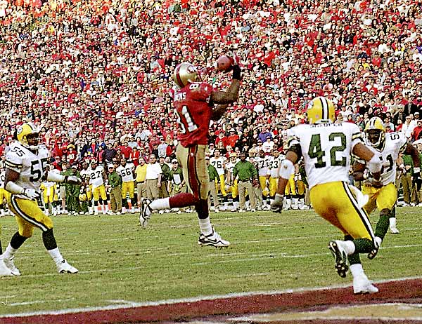 Owens' dramatic touchdown catch against the Packers in the NFC wild-card game gave the 49ers a 30-27 victory.