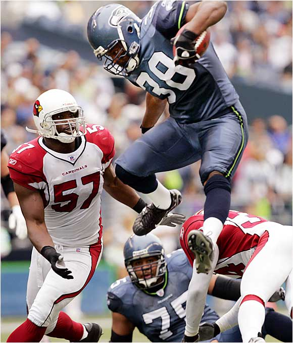 Seahawks fullback Mack Strong contributed to his team's running attack despite only three carries, rushing for 30 yards and a touchdown in Seattle's 21-10 victory over the Cardinals.