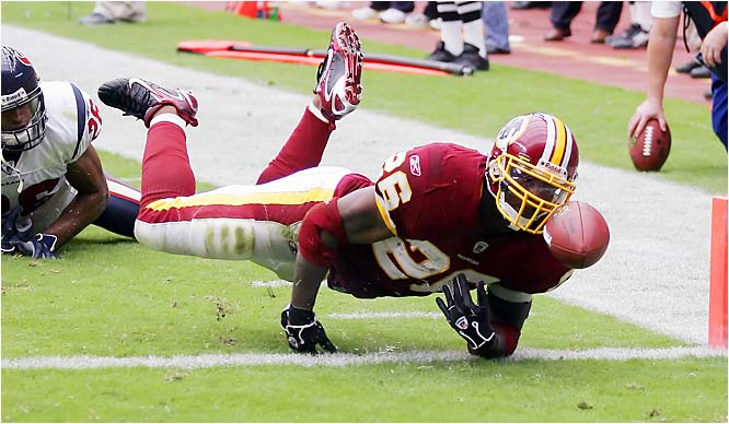 Redskins running back Clinton Portis rushed for two touchdowns in Washington's first win of the season. One of the scores came after the replay official ruled that Portis was down before fumbling the ball out of the end zone in the third quarter.