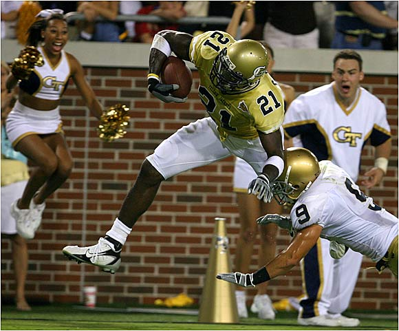 Calvin Johnson of Georgia Tech gets knocked out of bounds by Tom Zbikowski.