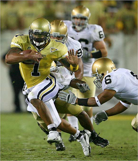 Georgia Tech quarterback Reggie Ball, who had 75 yards on the ground and 140 in the air, fends off Notre Dame's Ray Herring (6).