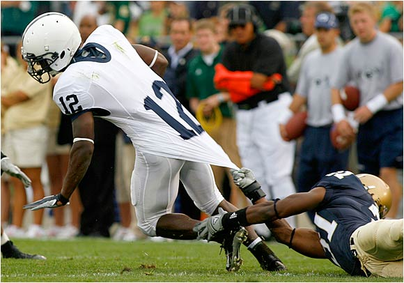 Notre Dame's Sergio Brown (31) gets a fistful of A.J. Wallace's jersey in an attempted tackle.