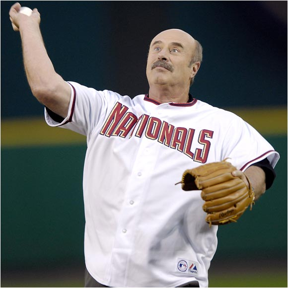 Dr. Phil can't stop looking at how empty the stands are at a recent Nationals game.