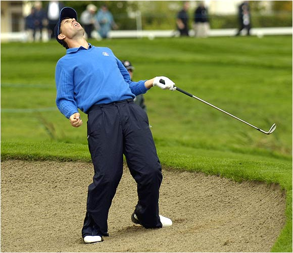 Padraig Harrington reacts after he just misses draining a bunker shot during Saturday's foursome play.