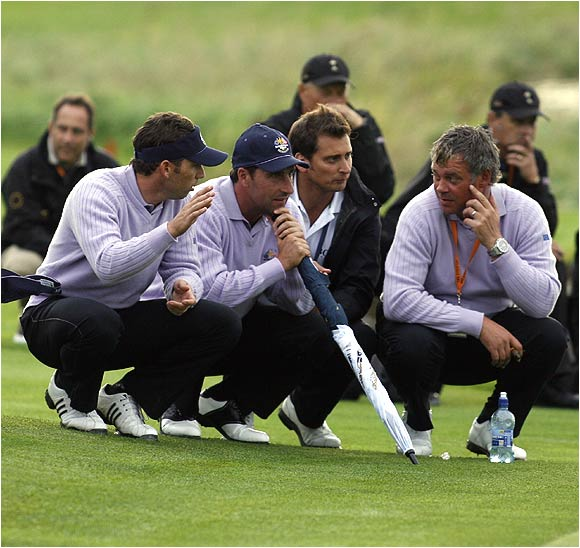 Sergio Garcia (left), Jose Maria Olazabal (center) and Darren Clarke talk strategy during Saturday's action.