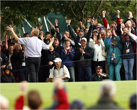 Colin Montgomerie celebrates after chipping in on the 9th green during the afternoon foursomes.
