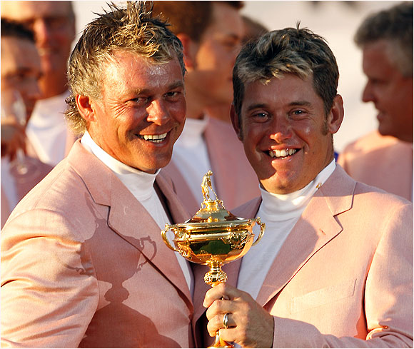 Grinning from ear to ear, Darren Clarke and Lee Westwood gratefully pose with the Ryder Cup trophy.