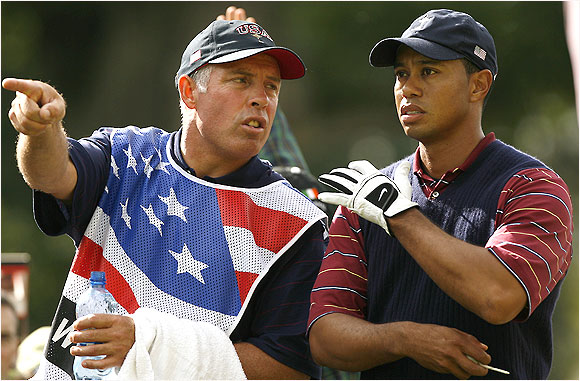 Caddie Steve Williams confers with Tiger Woods during a singles match against Robert Karlsson. Woods won 3 and 2.