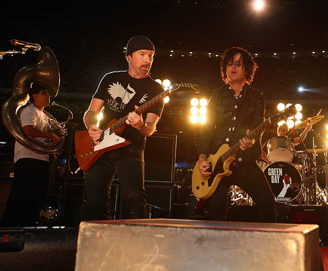 Pulling out all the stops: A Super Bowl-like pregame show included a performance by supergroups U2 and Green Day.