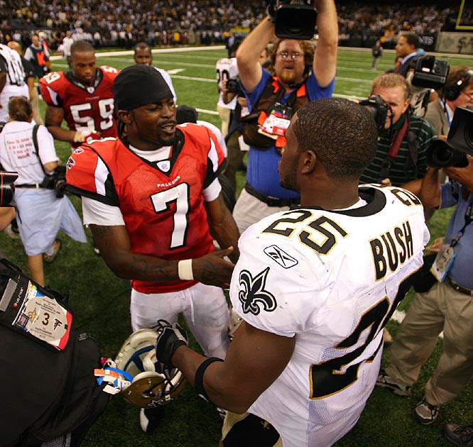 Michael Vick (left) congratulates Reggie Bush after the Saints' 23-3 victory in the first game at the Superdome in nearly two years.