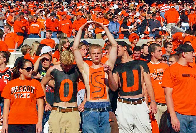 Oregon State fans wore the OSU logo on their bare chests as they cheered the Beavers during their game against Washington State on Saturday.