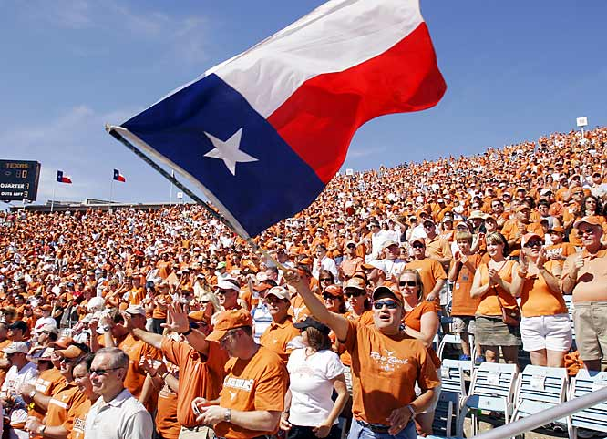 A Longhorns fan waved a Texas state flag before the start of the annual Texas/Oklahoma game.