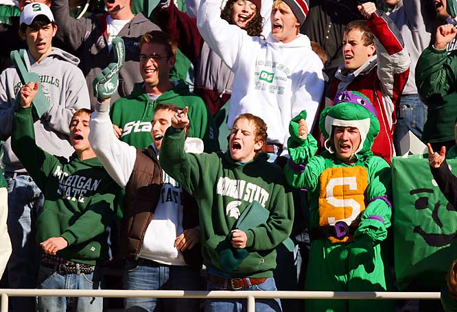 Early in the game, these Michigan State fans hold out hope that the Spartans could beat the No. 1 Buckeyes.