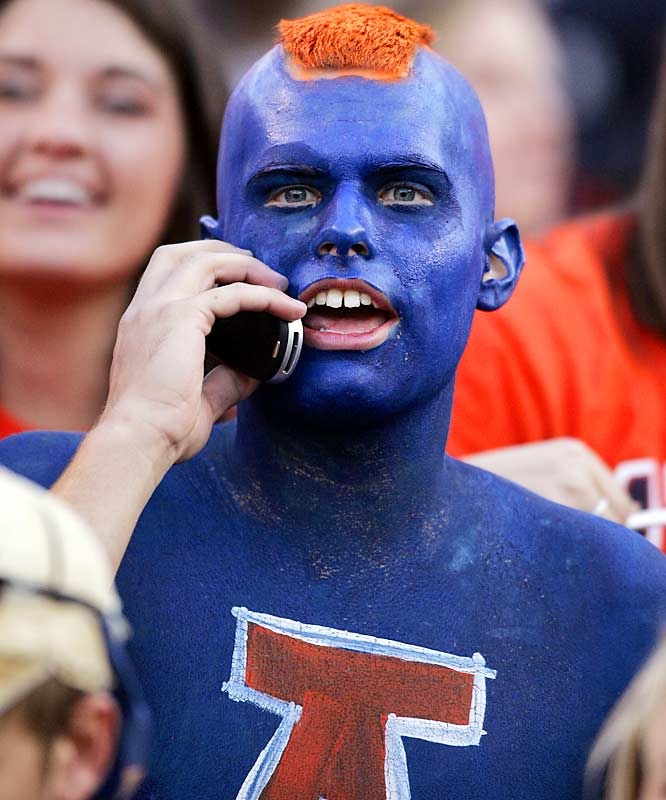 We give this fan credit for the face paint and orange mohawk, but he loses points for talking on the phone in the middle of an SEC battle.